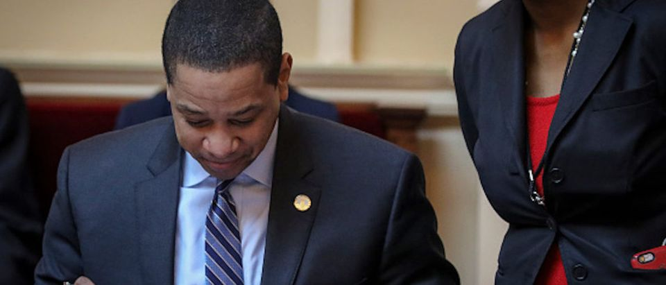 Virginia Lt. Governor Justin Fairfax (L) reads over a document on the Senate floor at the Virginia State Capitol, February 8, 2019 in Richmond, Virginia
