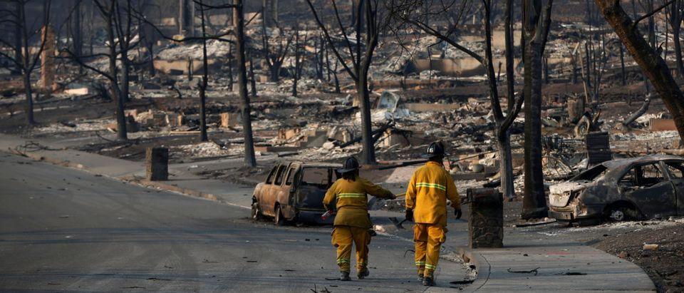 Firefighters walk in a neighborhood destroyed by the Tubbs Fire in Santa Rosa, California, U.S., Oct. 13, 2017. REUTERS/Stephen Lam