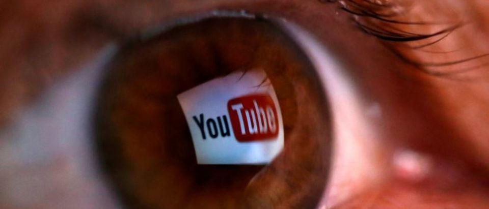 A picture illustration shows a YouTube logo reflected in a person's eye June 18, 2014. REUTERS/Dado Ruvic/Illustration/File photo