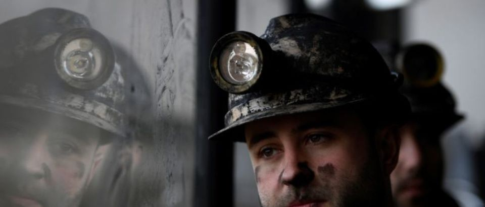 """Coal miners sit in a bus on the way to the mine """"La Escondida"""" (The hidden one) in Villablino, Spain, December 27, 2018. Picture taken December 27, 2018. REUTERS/Eloy Alonso"""