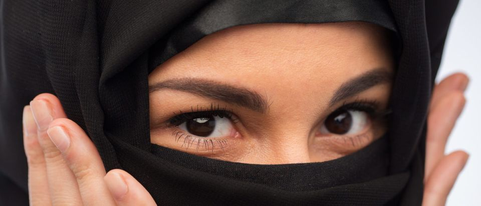 A woman wears a hijab. Shutterstock image via user Syda Productions