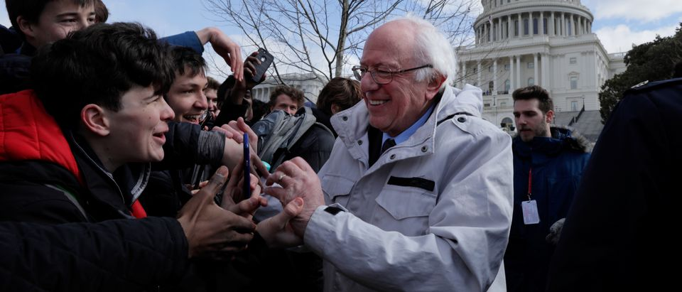 U.S. Senator Sanders greets students gathering outside the U.S. Capitol as part of a nationwide walk-out of classes to demand stricter gun laws in Washington