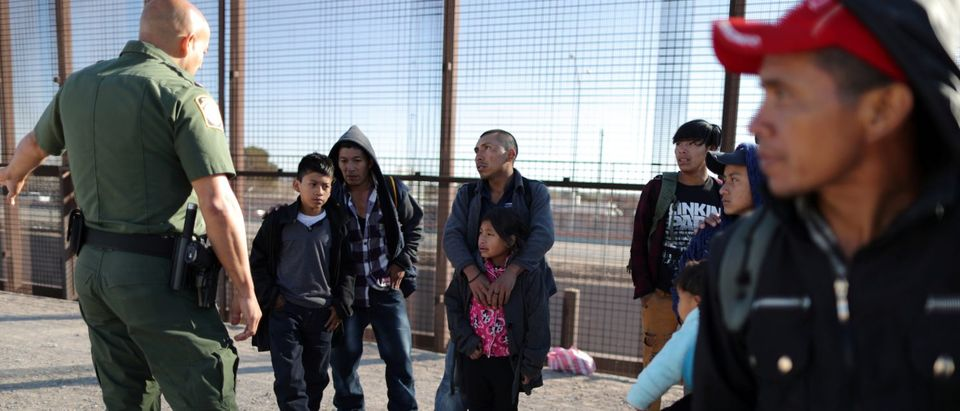 FILE PHOTO: A group of Central American migrants is questioned about their children's health after surrendering to U.S. Border Patrol Agents south of the U.S.-Mexico border fence in El Paso, Texas, U.S., March 6, 2019. REUTERS/Lucy Nicholson/File Photo