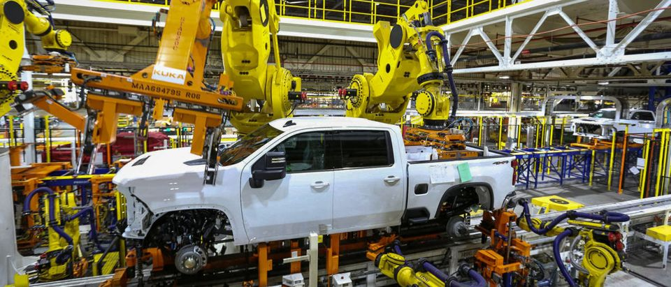 Robots swing a cab and bed into place for a new heavy duty pickup truck on the assembly line where Chevrolet Silverado trucks are being built at General Motors Flint Assembly in Flint, Michigan, U.S., Jan. 30, 2019. John F. Martin/Chevrolet/Handout via REUTERS