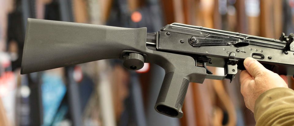 A bump stock device, (left) that fits on a semi-automatic rifle to increase the firing speed is installed on a AK-47 at a gun store on October 5, 2017 in Salt Lake City, Utah. (George Frey/Getty Images)