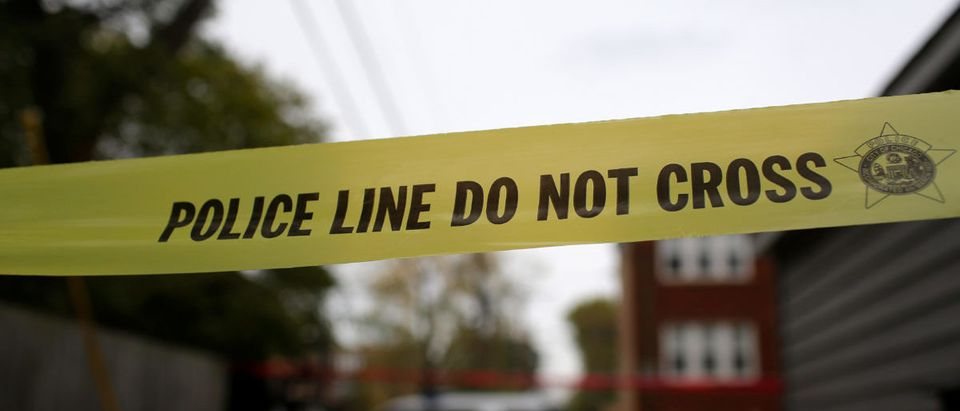 Yellow police tape is displayed at a crime scene after a motorist was shot in the head in Chicago