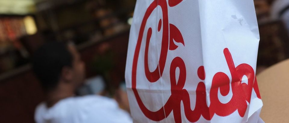 A Chick-fil-A logo is seen on a take out bag at one of its restaurants on July 28, 2012 in Bethesda, Maryland. Chick-fil-A, with more than 1,600 outlets mainly in the southern United States, has become the target of gay rights activists and their allies after president Dan Cathy came out against same-sex marriage last week. (MANDEL NGAN/AFP/GettyImages)