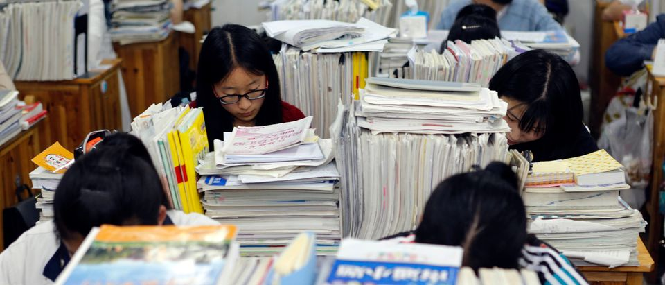 This photo taken on May 24, 2016 shows senior high school students studying at night to prepare for the college entrance exams at a high school in Lianyungang, east China's Jiangsu province. (Photo STR/AFP/Getty Images)