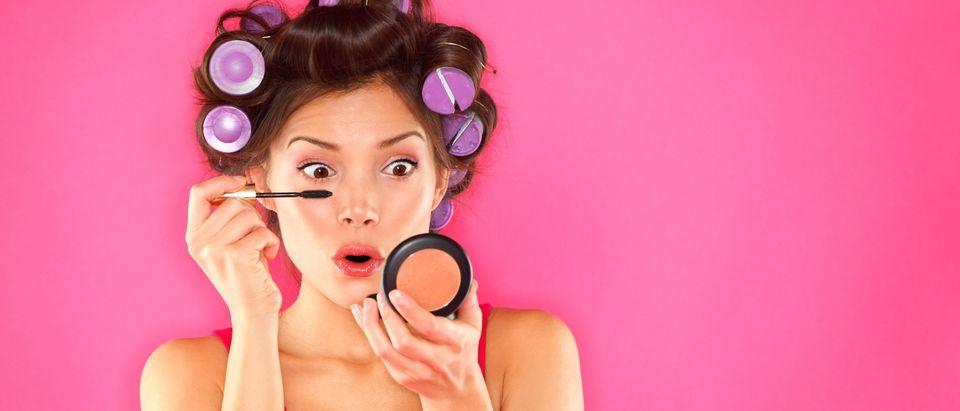 Young Woman Applies Makeup