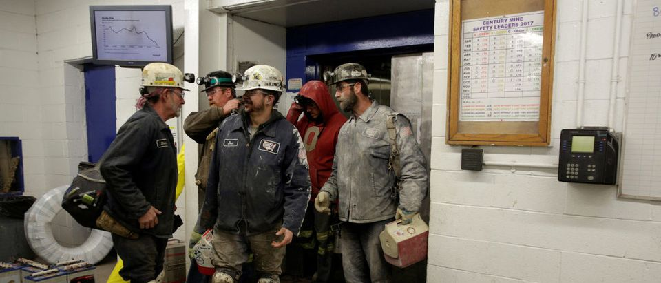 Miners starting and end their shifts greet each other at the Century Mine in Beallsville, Ohio, U.S., November 7, 2017. REUTERS/Joshua Roberts