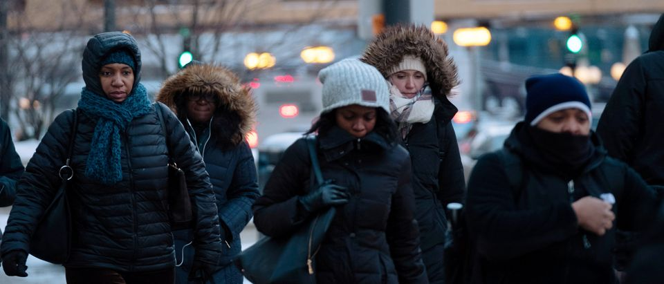 Pedestrians cross the street at rush hour as bitter cold phenomenon called the polar vortex has descended on much of the central and eastern United States