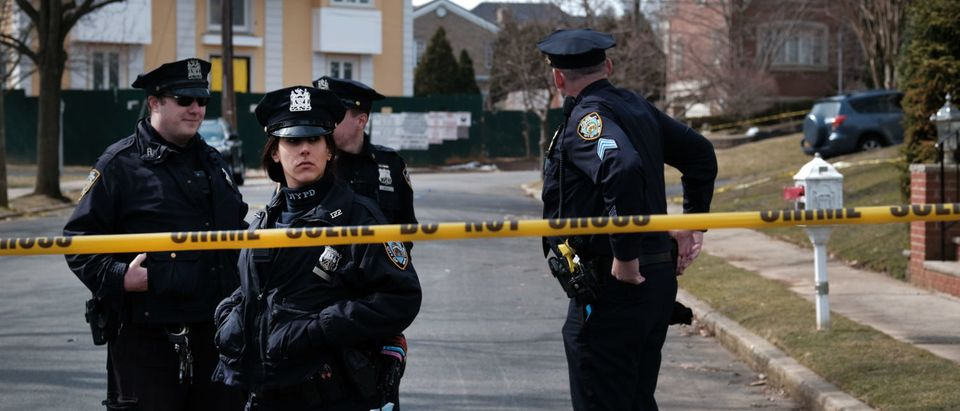 "Police stand along the street where reputed mob boss Francesco ""Franky Boy"" Cali lived and was gunned down on March 14, 2019 in the Todt Hill neighborhood of the Staten Island borough of New York City. (Photo by Spencer Platt/Getty Images)"