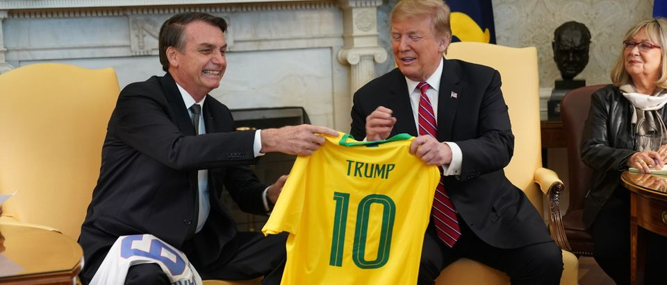 Brazilian President Jair Bolsonaro presents U.S. President Donald Trump with a Brazil national soccer team jersey Number 10 for striker position at the White House March 19, 2019 in Washington, DC. (Photo by Chris Kleponis-Pool/Getty Images)