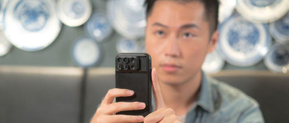 Guy Holding Phone