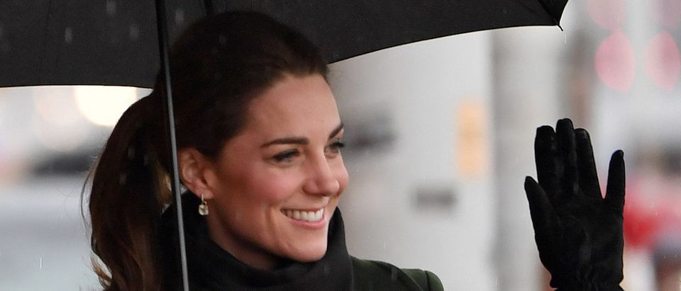 Britain's Catherine, Duchess of Cambridge shelters from the rain beneath an umbrella as she arrives to visit Blackpool Tower in Blackpool, north-west England on March 6, 2019. (Photo credit: PAUL ELLIS/AFP/Getty Images)