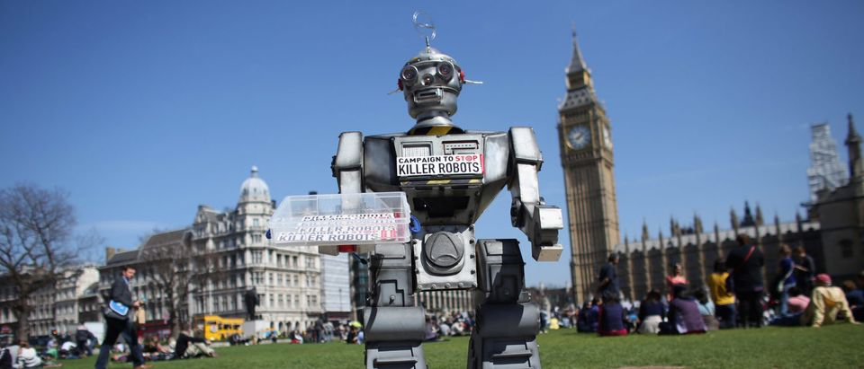 LONDON, ENGLAND - APRIL 23: A robot distributes promotional literature calling for a ban on fully autonomous weapons in Parliament Square on April 23, 2013 in London, England. (Photo by Oli Scarff/Getty Images)