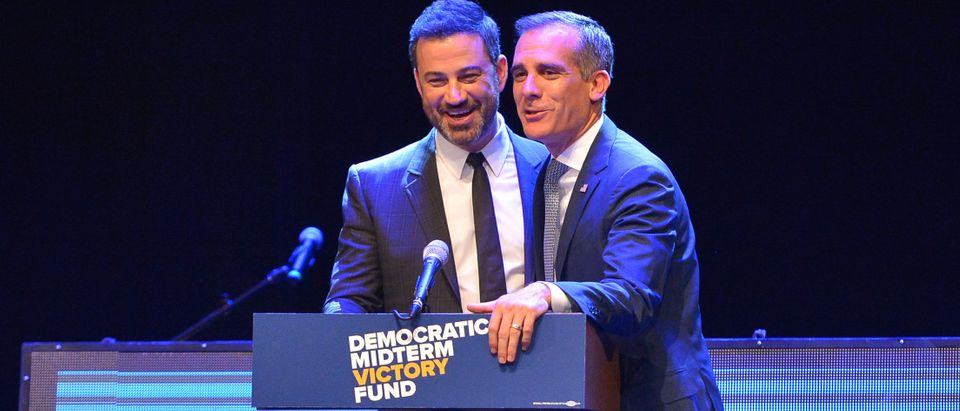 Jimmy Kimmel and Los Angeles Mayor Eric Garcetti speak onstage at 1 Night, $1 Million, 10 States, 100s Of Victories With Eric Garcetti, Jimmy Kimmel, And Dj Khaled on Sept. 25, 2018 in Los Angeles, California. (Photo by Charley Gallay/Getty Images for Democratic Midterm Victory Fund)