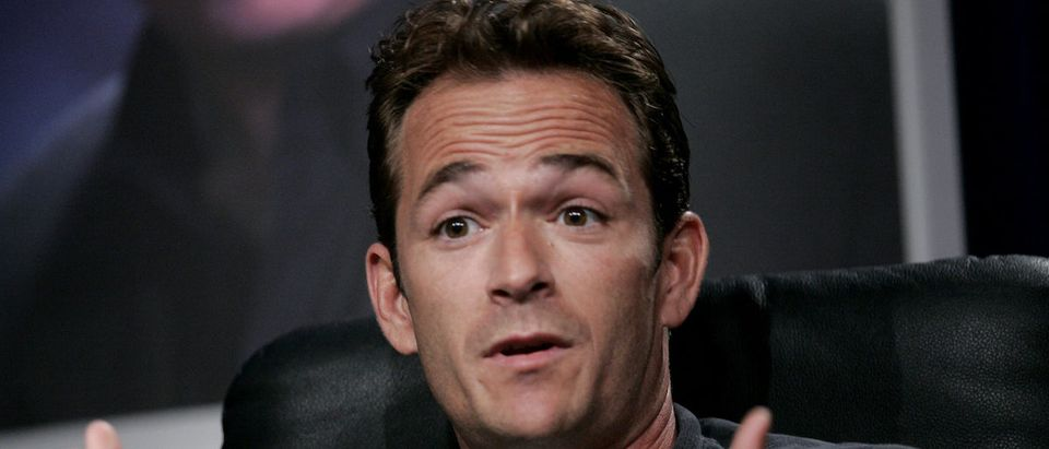 "Actor Luke Perry reacts at the panel for Hallmark channel's ""Supernova"" show during the Television Critic's Association Summer press tour at the Beverly Hilton Hotel, Beverly Hills, July 16, 2005. REUTERS/Mario Anzuoni/File Photo"