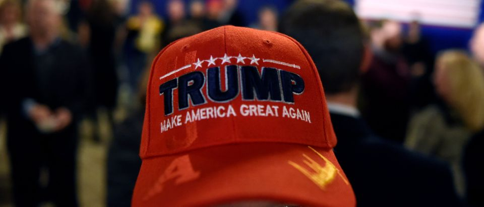 A supporter is seen wearing a Donald Trump hat at Republican Governor Scott Walker's mid-term election night party in Pewaukee, Wisconsin, U.S. November 6, 2018. REUTERS/Nick Oxford