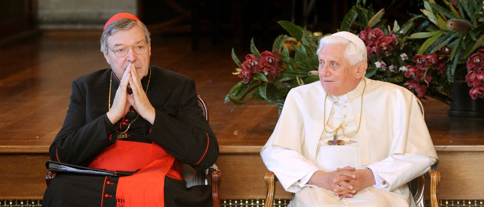SYDNEY, AUSTRALIA - JULY 18: (L-R) Catholic Archbishop of Sydney Cardinal George Pell and His Holiness Pope Benedict XVI attend a meeting with Heads of Other Faiths at St Mary's Cathedral Chapter Hall during World Youth Day Sydney 2008 on July 18, 2008 in Sydney, Australia. Organised every two to three years by the Catholic Church, World Youth Day (WYD) is an invitation from the Pope to the youth of the world to celebrate their faith. The celebration, being held in Sydney from July 15, 2008 to July 20, 2008, will mark the first visit of His Holiness Pope Benedict XVI to Australia. (Photo by William West-Pool/Getty Images)