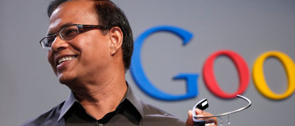 Amit Singhal, senior vice president of search at Google, holds a Google Glass as he speaks at the garage where the company was founded on Google's 15th anniversary in Menlo Park, California September 26, 2013 (REUTERS/Stephen Lam)