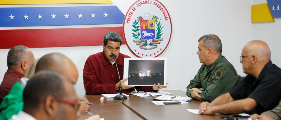 Venezuela's President Nicolas Maduro speaks during a meeting with members of the government in Caracas