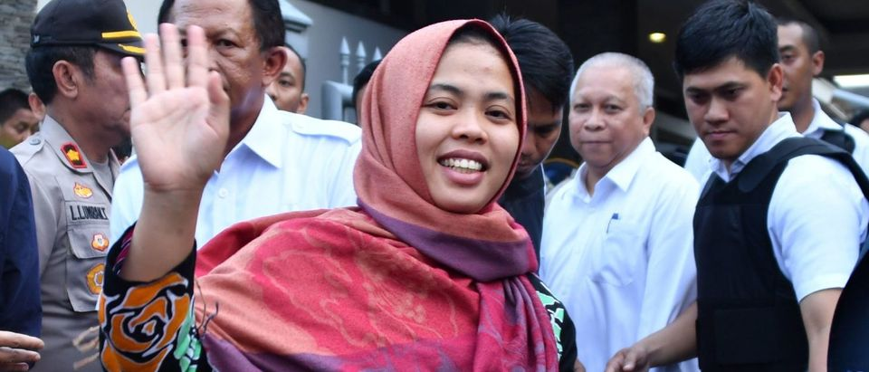 Indonesian Siti Aisyah waves after a press conference in Jakarta on March 11, 2019.(ADEK BERRY/AFP/Getty Images)