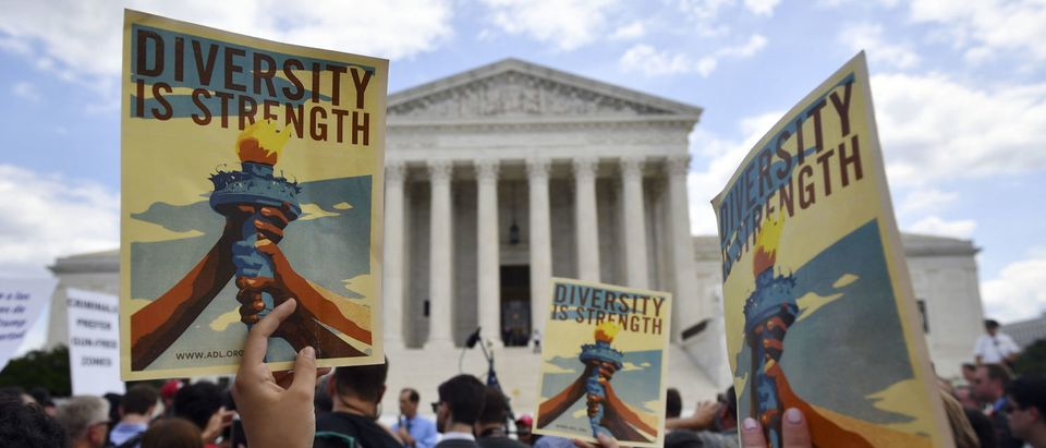 People protest the travel ban outside of the Supreme Court on June 26, 2018. (Mandel Ngan/AFP/Getty Images)