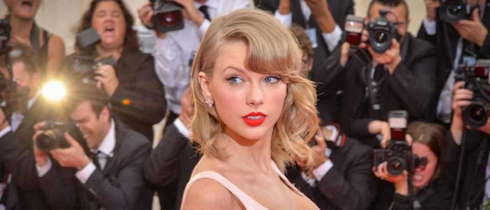 """Singer Taylor Swift attends the """"Charles James: Beyond Fashion"""" Costume Institute Gala at the Metropolitan Museum of Art on May 5, 2014 in New York City. (Photo by Andrew H. Walker/Getty Images)"""