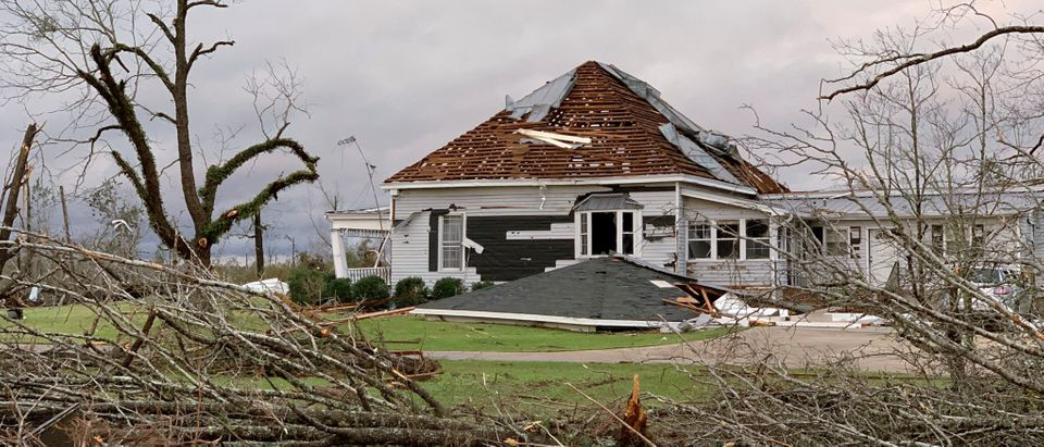 Debris and a damaged house are seen following a tornado in Beauregard, Alabama
