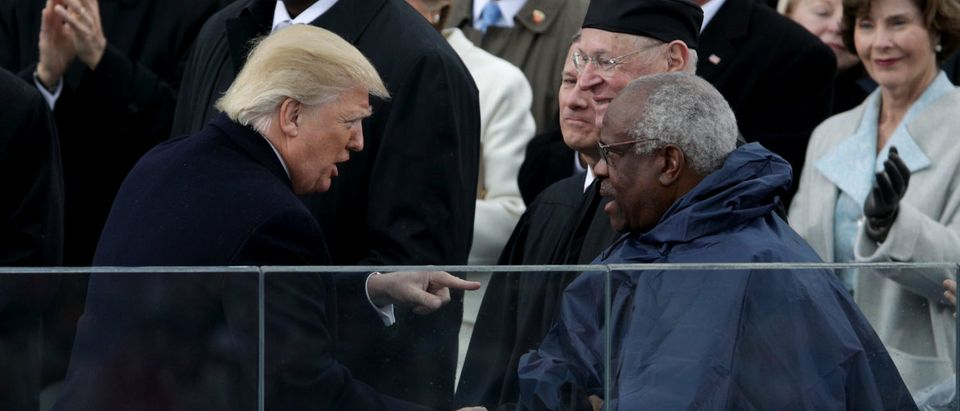 President Donald Trump shakes hands with Justice Clarence Thomas on the West Front of the U.S. Capitol on Jan. 20, 2017 in Washington, D.C. (Alex Wong/Getty Images)