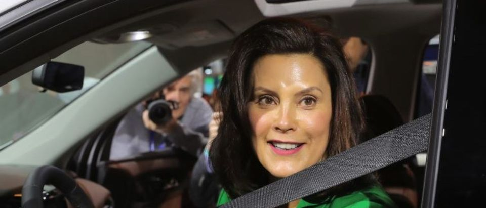 Michigan Governor Gretchen Whitmer sits in a 2019 Chevrolet Traverse, assembled in Lansing, Michigan, at the General Motors display area during the North American International Auto Show in Detroit, Michigan, U.S., January 15, 2019. REUTERS/Rebecca Cook