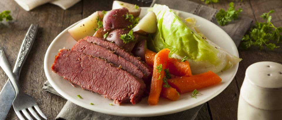 Corned beef is served with cabbage and carrots. Shutterstock image via user Brent Hofacker