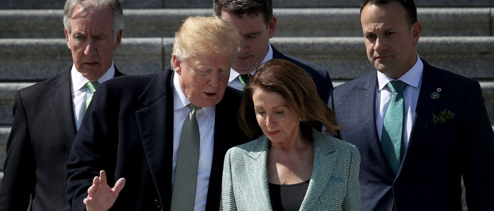 U.S. President Donald Trump confers with Speaker of the House Nancy Pelosi while departing the U.S. Capitol following a St. Patrick's Day celebration on March 14, 2019 in Washington, DC. (Photo by Win McNamee/Getty Images)