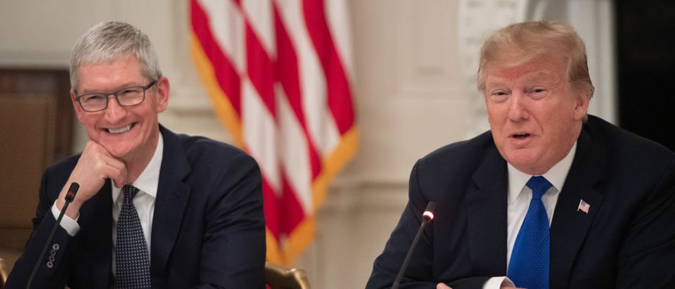 US President Donald Trump speaks alongside Apple CEO Tim Cook (L) during the first meeting of the American Workforce Policy Advisory Board in the State Dining Room of the White House in Washington, DC, March 6, 2019. (SAUL LOEB/AFP/Getty Images)
