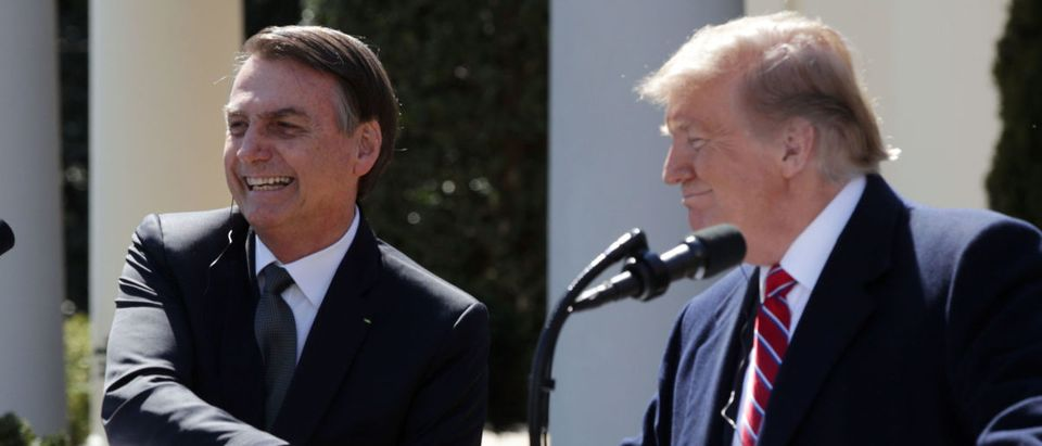 U.S. President Donald Trump and Brazilian President Jair Bolsonaro participate in a joint news conference at the Rose Garden of the White House March 19, 2019 in Washington, DC. (Photo by Alex Wong/Getty Images)