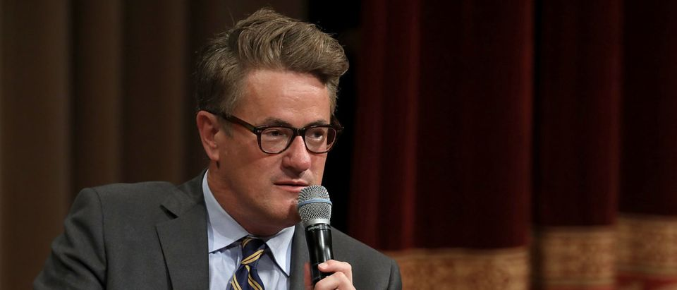MSNBC 'Morning Joe' host Joe Scarborough speaks during an interview with his co-host Mika Brzezinski and philanthropist and financier David Rubenstein during a Harvard Kennedy School Institute of Politics event in the McGowan Theater at the National Archives July 12, 2017 in Washington, DC. Chip Somodevilla/Getty Images