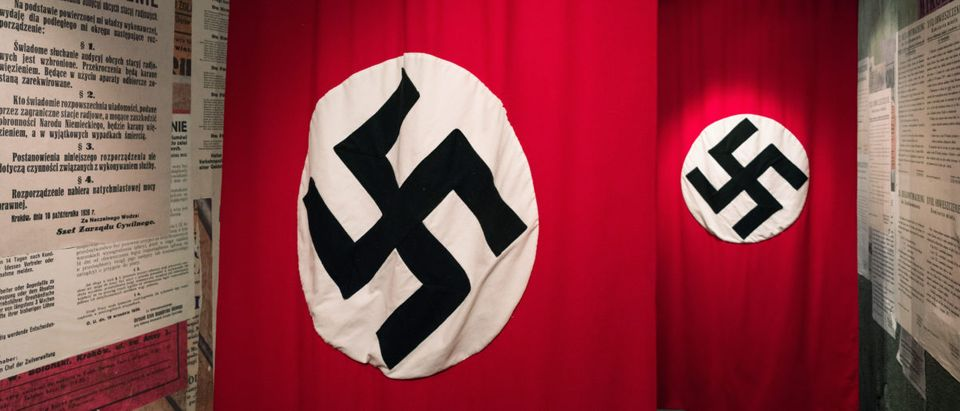 Swastika - flag in Oskar Schindler's Enamel factory museum on February 19, 2018 in Krakow, Poland. Shutterstock image via user Jaroslav Moravcik
