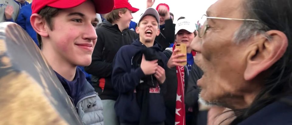 Nicholas Sandmann, 16, a student from Covington Catholic High School stands in front of Native American activist Nathan Phillips in Washington, U.S., in this still image from a January 18, 2019 video by Kaya Taitano. Kaya Taitano/Social Media/via REUTERS