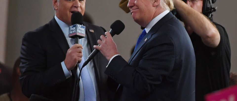 Fox News Channel and radio talk show host Sean Hannity (L) interviews U.S. President Donald Trump before a campaign rally at the Las Vegas Convention Center on September 20, 2018 in Las Vegas, Nevada. (Photo by Ethan Miller/Getty Images)