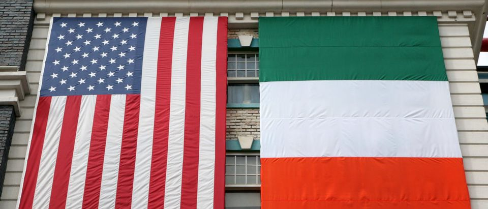 American and Irish flags hanging on an old building
