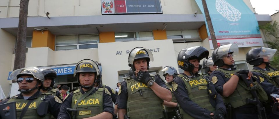 Police officers stand guard outside the Casimiro Ulloa Emergency Hospital in Lima where Peruvian ex-president Alan Garcia is undergoing emergency surgery on April 17, 2019 after shooting himself in the head at his home as police were about to arrest him in a sprawling corruption case. (LUKA GONZALES/AFP/Getty Images)