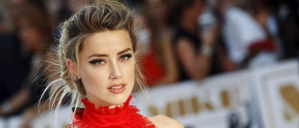 "Actress Amber Heard poses at the European premiere of ""Magic Mike XXL"" at Leicester Square in London, Britain June 30, 2015. REUTERS/Luke MacGregor"