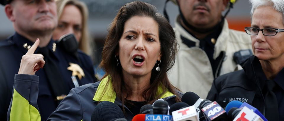 Oakland Mayor Libby Schaaf speaks to members of the media at the scene of a fatal warehouse fire in the Fruitvale district of Oakland, California
