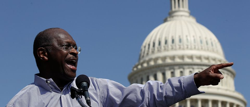 "Former Republican presidential candidate Herman Cain speaks at the ""Cain's Revolution on the Hill"" Tax Day Rally at the U.S. Capitol April 16, 2012 in Washington, DC.(Photo by Win McNamee/Getty Images)"
