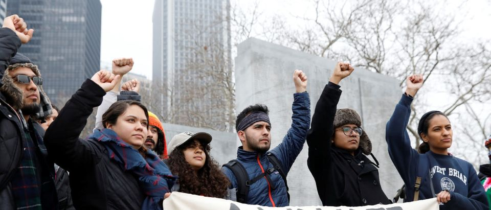 Activists and DACA recipients raise their fists before the start of their 'Walk to Stay Home,' a five-day 250-mile walk from New York to Washington D.C., to demand that Congress pass a Clean Dream Act, in Manhattan, New York, U.S., February 15, 2018. REUTERS/Shannon Stapleton