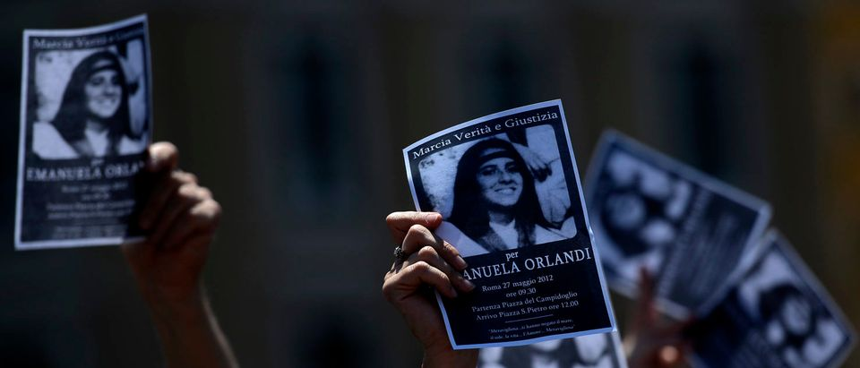 "A demonstrator holds a poster of Emanuela Orlandi reading ""Missing"" during Pope Benedict XVI's Regina Coeli noon prayer in St. Peter's square, at the Vatican on May 27, 2012. (FILIPPO MONTEFORTE/AFP/GettyImages)"