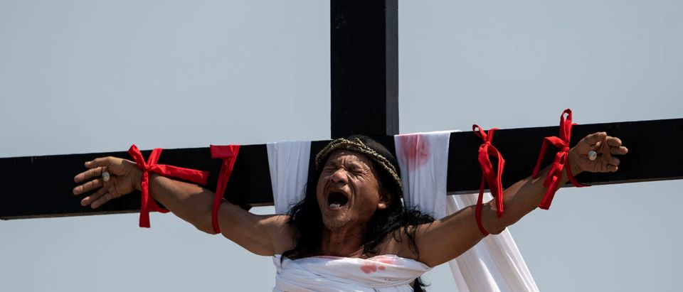 Philippine Christian devotee Ruben Enaje, 58, reacts as he is nailed to a cross during a reenactment of the Crucifixion of Christ during Good Friday ahead of Easter in the village of Cutud near San Fernando on April 19, 2019. (NOEL CELIS/AFP/Getty Images)