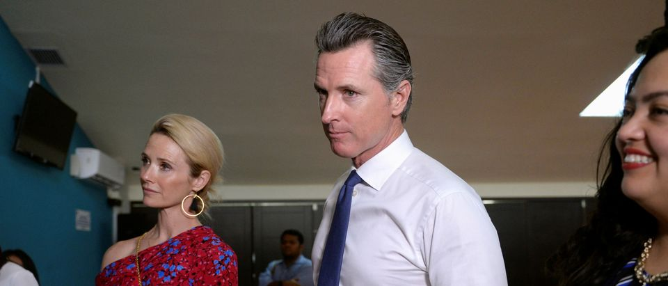 Gov. of U.S. state of California Gavin Newsom and his wife Jennifer Siebel Newsom visit the premises of a migrant assistance office in San Salvador, El Salvador, April 8, 2019. REUTERS/Jessica Orellana.