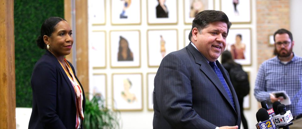 Illinois gubernatorial candidate J.B. Pritzker stands with his Illinois gubernatorial Lieutenant Governor candidate Juliana Stratton as he speaks to reporters after sitting with high school students during a round table discussion at a creative workspace for women on October 1, 2018 in Chicago, Illinois. (Photo by Joshua Lott/Getty Images)